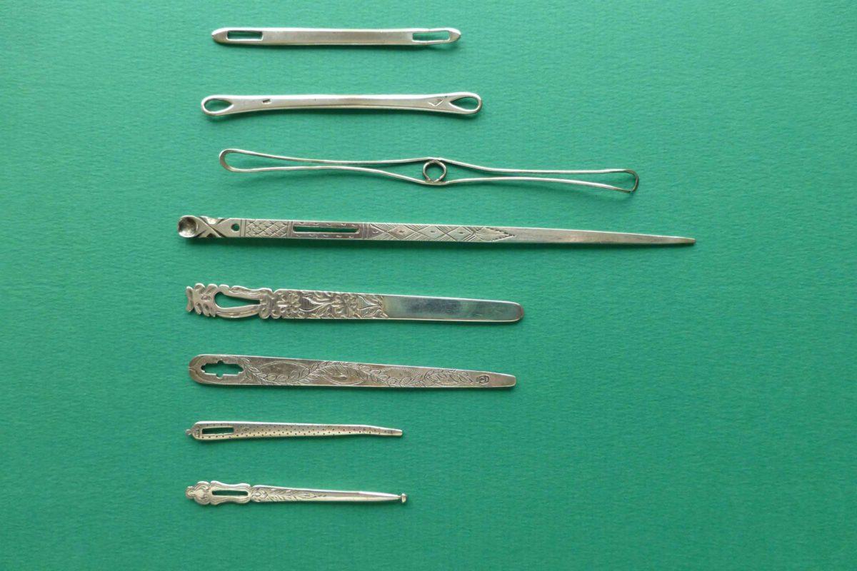 antieke zilveren rijgnaalden