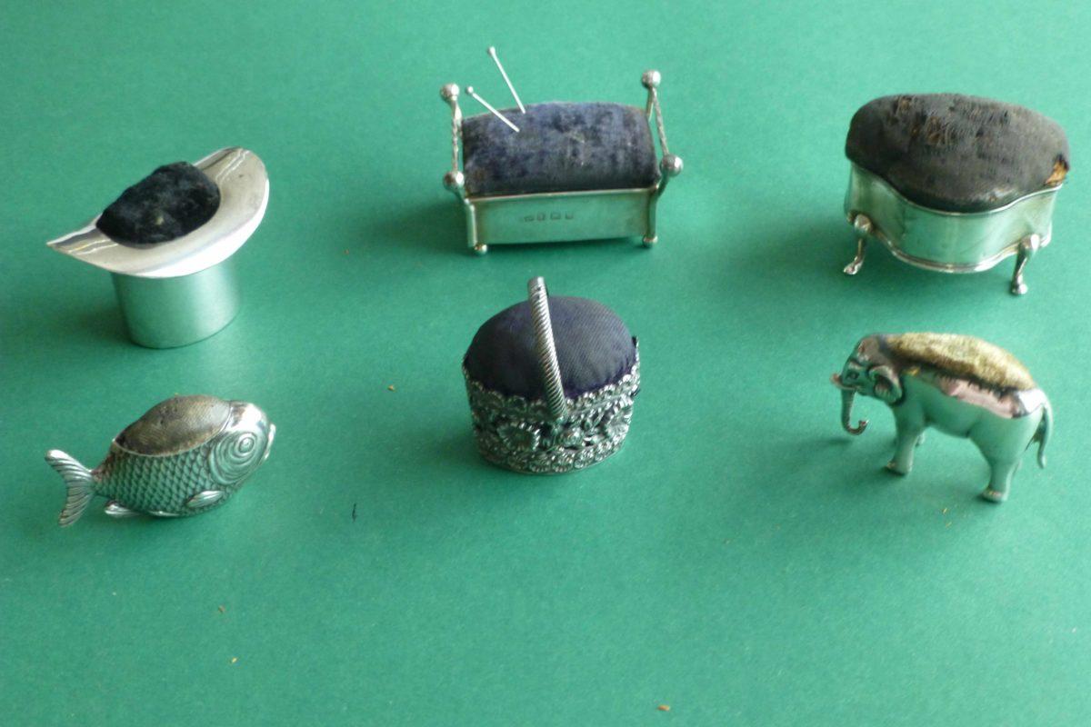 antieke zilveren speldenkussentjes