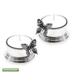Zilveren waxinelichthouders met vlinders